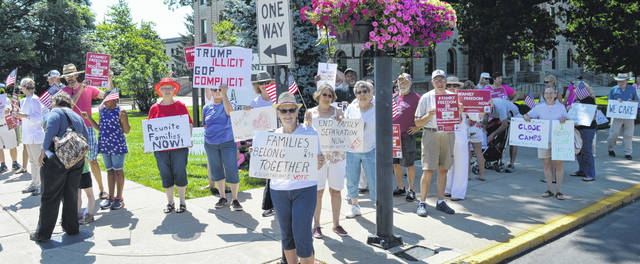Locals gathered at the Clinton County Court House on Saturday at the Families Belong Together rally. The rally was to protest President Trump's immigration policy that separated children from their parents who crossed the border illegally.