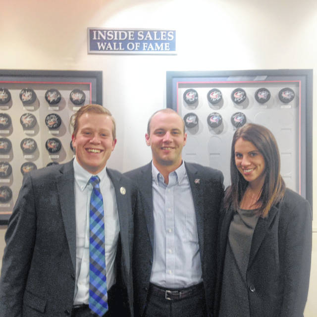 From a 2015 photo, Justin Dunn (middle) along with sales reps for the Blue Jackets Noah Heiber (currently an account executive with the Blue Jackets) and Taylor Kuehl (now with Google).