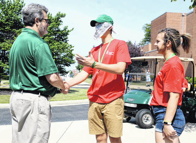 "Engaging in a ""trust walk"" activity at Wilmington College's Summer Leadership Plunge, Abby Ruth of Helena, Ohio leads a blindfolded Bradley Paxton, of Winter Haven, Fla., through the campus, stopping along the way at various landmarks like the Campus Rock and the Harvey Statue. En route to their next stop, they happened to run into WC President Jim Reynolds — or so Bradley was told."