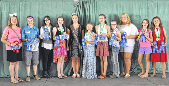 The 2018 Clinton County Junior Fair Creative Arts winners include, from left, Briana Mobley, Savannah Henderson, Alyssa Hutchinson, Noella Robertson, FSC Queen Carrie Robinson, Lynnea Dean, Tess Pringnitz, Maya Murphy, Makayla Henry, Rhyla Jordan, and Autumn Smith.