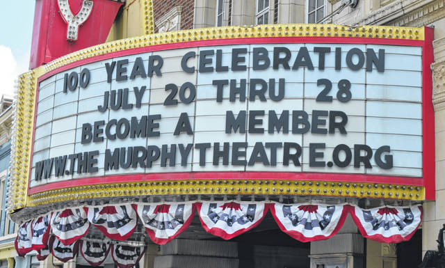 Decorative bunting hangs from the Murphy Theatre marquee which bears a message about a week-long series of events to celebrate 100 years as a downtown venue.