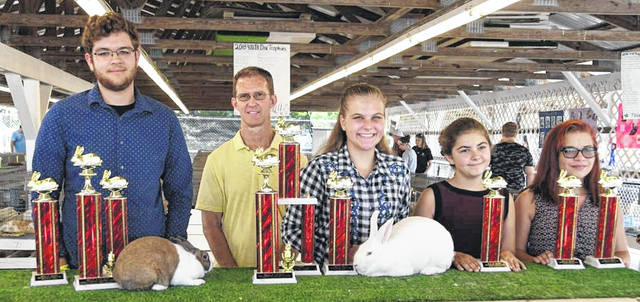 Open Youth Rabbit Show winners include, from left, Conner Cook, Judge Kevin Hooper, Best In Show Morgan Wiget, Autumn Smith, and Abigail Babcock. Not available for photos were Cooper Dillion and Addison Beckett.