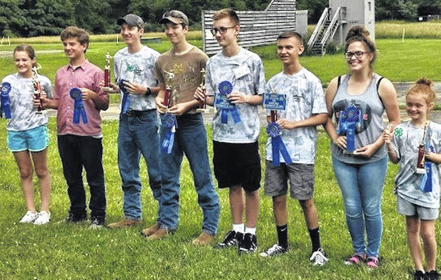 """Pictured from left are the winners at the 2018 Shooting Sports (rifle, shotgun, pistol and archery) competitive event for the Clinton County Junior Fair: Mikayla Wonderly, John """"Drew"""" Dobyns, Timothy Ritchey, Jacob Ritchey, Andrew Delph, Holden Balon, Cheyenne Jarrell and Sydney Bennett."""