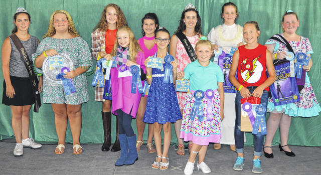 First-place winners and state fair qualifiers in the Style Review and Clothing Awards show are, from left in the front row, Kensey Parker, Catherine Synan, Alexis Murphy and Sydney Doyle; and from left in the back row, Family and Consumer Sciences Queen Carrie Robinson, Makayla Henry, Courtney Parker, Paige Bryant, Clinton County Junior Fair Queen Falesa Fyffe, Mercy Persing and Jenna Allemang.
