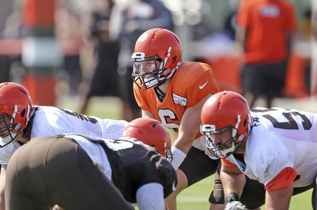 Cleveland Browns quarterback Baker Mayfield prepares for the snap during the NFL football team's scrimmage at training camp Friday, Aug. 3, 2018, in Berea, Ohio. (Joshua Gunter/Cleveland.com via AP)