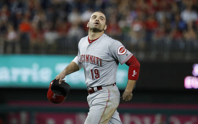 Cincinnati Reds' Joey Votto yells to the Washington Nationals' dugout as he walks off the field during the eighth inning of the second baseball game of a doubleheader at Nationals Park, Saturday, Aug. 4, 2018, in Washington. Votto was hit by a pitch after Washington Nationals' Bryce Harper and Spencer Kieboom were hit by pitches. The Nationals won 6-2. (AP Photo/Alex Brandon)