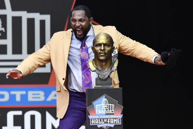 Former Baltimore Ravens linebacker Ray Lewis dances beside his bust as he delivers his induction speech at the Pro Football Hall of Fame Saturday, Aug. 4, 2018, in Canton, Ohio. (AP Photo/David Richard)