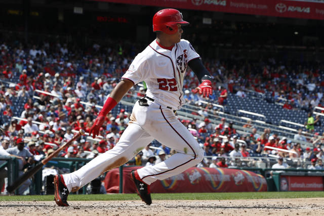 Washington Nationals' Juan Soto (22) hits a pitch during the fifth inning of a baseball game against the Cincinnati Reds at Nationals Park, Sunday, Aug. 5, 2018, in Washington. (AP Photo/Jacquelyn Martin)