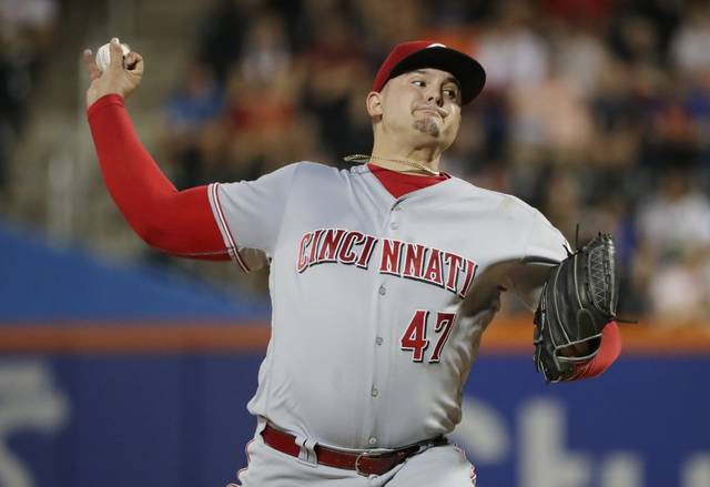 Cincinnati Reds' Sal Romano delivers a pitch during the second inning of the team's baseball game against the New York Mets on Tuesday, Aug. 7, 2018, in New York. (AP Photo/Frank Franklin II)