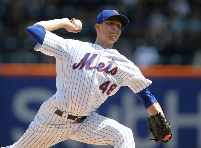 New York Mets' Jacob deGrom pitches in the first inning against the Cincinnati Reds in a baseball game Wednesday, Aug. 8, 2018, in New York. (Jim McIsaac/Newsday via AP)