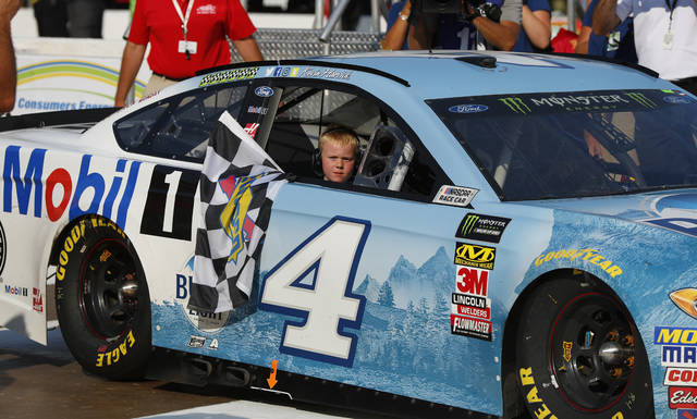 Kevin Harvick's son, Keelan, rides into Winner's Circle with his father after a NASCAR Cup Series auto race at Michigan International Speedway in Brooklyn, Mich., Sunday, Aug. 12, 2018. (AP Photo/Paul Sancya)