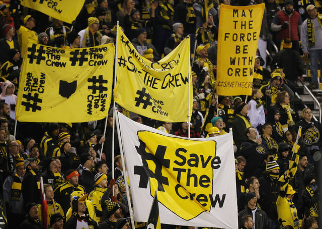 FILE - In this Oct. 31, 2017, file photo, Columbus Crew fans show their support for the team before the start of their MLS Eastern Conference semifinal soccer match against New York City FC in Columbus, Ohio. The Austin City Council is scheduled to decide Wednesday, Aug. 15, 2018 whether to move ahead with a stadium plan that could prompt Major League Soccer's Columbus Crew to leave its home city after 22 years. (AP Photo/Jay LaPrete, File)