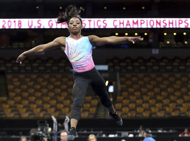 Simone Biles practices on the floor during a training session at the U.S. Gymnastics Championships, Wednesday, Aug. 15, 2018, in Boston. (AP Photo/Elise Amendola)