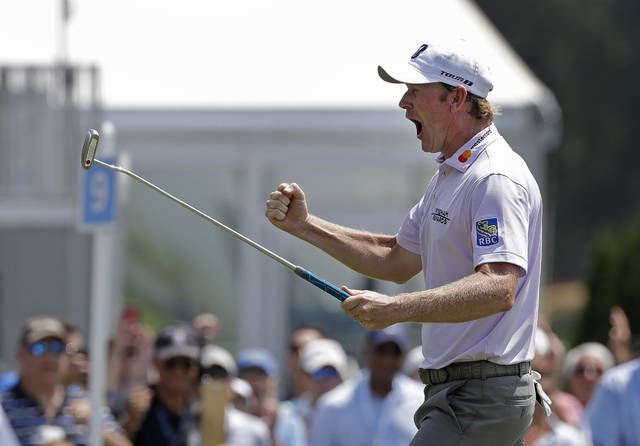 Brandt Snedeker reacts after making a birdie putt on the ninth hole during the first round of the Wyndham Championship golf tournament in Greensboro, N.C., Thursday, Aug. 16, 2018. Sneaker shot a 59 in the first round. (AP Photo/Chuck Burton)