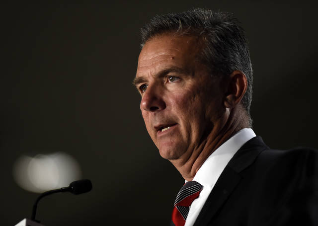 File-This July 24, 2018, file photo shows Ohio State head coach Urban Meyer speaking at the Big Ten Conference NCAA college football Media Days in Chicago. The Big Ten East has been called the toughest division in college football, and that's expected to be the case again this season even with the uncertainty surrounding Meyer and his defending conference champion Ohio State Buckeyes.  (AP Photo/Annie Rice, File)