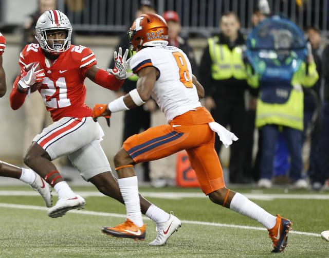 FILE - In this Nov. 18, 2017, file photo, Ohio State receiver Parris Campbell, left, fends off Illinois defensive back Nate Hobbs during the first half of an NCAA college football game in Columbus, Ohio. Campbell was the best receiver last season, with 594 yards and three scoring grabs. (AP Photo/Jay LaPrete, File)
