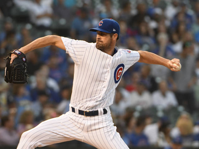 Chicago Cubs starting pitcher Cole Hamels throws to a Cincinnati Reds batter during the first inning of a baseball game Thursday, Aug. 23, 2018, in Chicago. (AP Photo/David Banks)