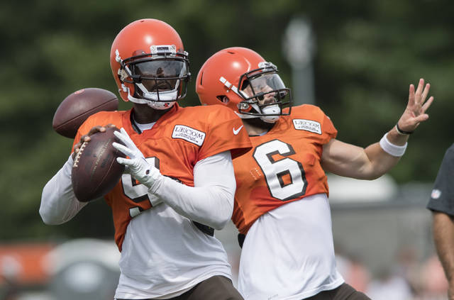 FILE - In this Aug. 2, 2018, file photo, Cleveland Browns quarterbacks Tyrod Taylor, left, and Baker Mayfield throw passes during NFL football training camp, in Berea, Ohio. Former Buffalo quarterback Tyrod Taylor will start while top overall pick Baker Mayfield develops. (AP Photo/Ken Blaze, File)