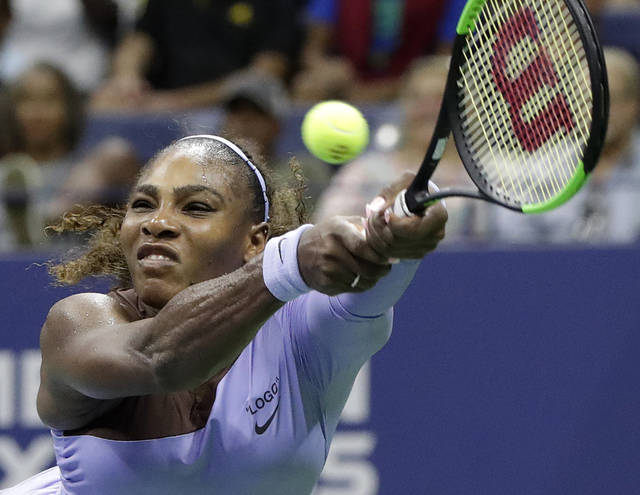 Serena Williams returns a serve by Carina Witthoeft, of Germany, during the second round of the U.S. Open tennis tournament, Wednesday, Aug. 29, 2018, in New York. (AP Photo/Julio Cortez)