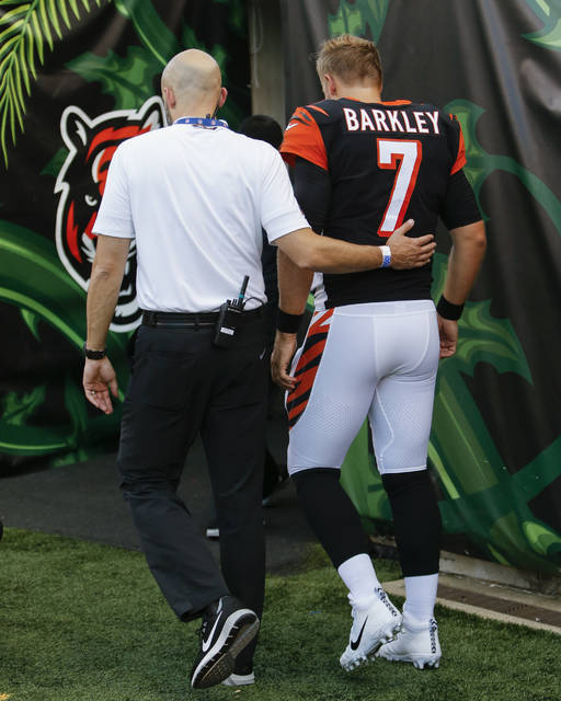 Cincinnati Bengals quarterback Matt Barkley (7) is helped off the field after an injury during the first half of the team's NFL preseason football game against the Indianapolis Colts, Thursday, Aug. 30, 2018, in Cincinnati. (AP Photo/Frank Victores)