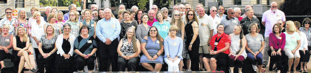 Seated in the first row are Debbie Holdren Sarkees, Colleen Smith Delegan, Susan Metz Burns, Roberta Phillips Glingle, Karen Rulon Gibson, Mary Collins Powell, Lelini Lisk Burns, Lois Minton, Mary Kelly Joseph, Sandy Trapnell Martin, Joni Bumgarner, Penny Greene Reedy, Pam Cowin Johnson, Robyn Reynolds Spragg, Dianna Guzzi Handy and Toni Hill Coy. In the second row are Karen Winterfield Simpkins, Linda Allen Schilling, Carrie Loving Devillbiss, Maggie Bayless, Mark Taylor, Jean Powell Singleton, Kathy Head O'Bradovick, Debbie Kinney Wilkin, Agnes Pennewitt Adams, Ginny Robinson Galloway, Gary Fisher, Norman Hamilton, Danny Cox and Tim Haley. In the third row are Dana Clouser, Robyn Brunn Marconet, Kay Brewer, Carol Kroll Caputo, (partially hidden) Becky Shutts Brinkmier, Mary Neanover Price, George Tilton, Roni Kersey, (hidden) Shelley Stephens Keiter, Cheryl Tinsley Henderson, Jane Powell Walker, Debbie Kneisel, Keith Hill, Bill Shoemaker, Ted Vance, Mike Sutton, Tommy Scott, Randy Moore, and (hidden) Bill Ross. And in the fourth row are Bob Quallen, Nancy Foland McKay, Ron Weintjes,(hidden but giving an uplifted peace sign) Lora Shaw Arant, Tom Hicks, Jeff Green, John Maple, Jeff Swindler, Doyle Schilling, Dave Hinman and Jim Leonard. Attending, but not pictured, Pete Breuleux.