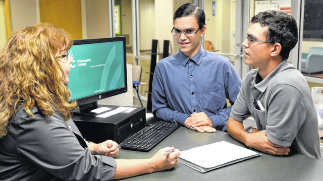 Blanchester High School graduates Timothy, right, and William Rannells meet with Wilmington College's Sonia Thompson, coordinator of the Clinton County SUCCEEDS program, during a recent campus visit. The brothers are among the more than 50 Clinton County students entering WC as freshmen later this month.