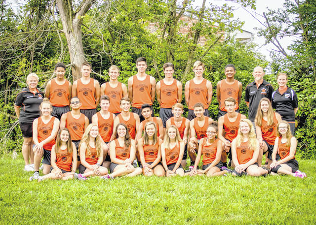 The Wilmington High School boys and girls cross country teams, from left to right, front row, Mackenzie Voges-Pertuset, Shannon O'Boyle, Skye Carpenter, Izzy Coomer, Sophia Agee, Sylena Baltazar, Annie Newberry and Mikala Hatfield; middle row, Libby Walker, Adonis Peterson, Brady McKinney, Calvin Walls, Pedro Escobedo, Cam Combs, Tyler Parks, Tyler Preston, and Jordan Snarr; back row, coach Eileen Grosse, Tony Wilens-Mabry, Luke Mulvey, Aidan Hester, Matt Butcher, Simon Heys, Ricky Dungan, Izaia Billingsley, coach Brad Heys, and coach Karen Heslop. Team members Brandon Walters and Jake Martin were not present for the photo.