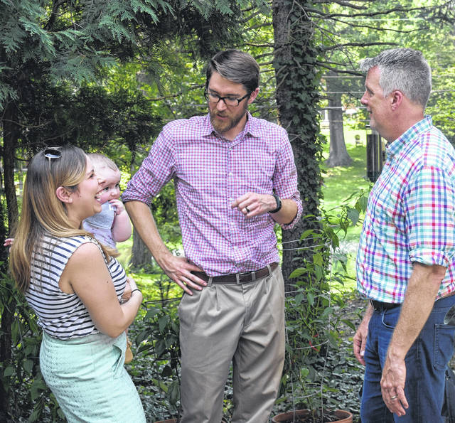 Congressional candidate Rick Neal, right, chats with Wilmington City Councilmember Tyler Williams, middle, his wife Sara, and their son George at a fundraising event for Neal on Saturday in Wilmington. Neal is the Democratic nominee running against incumbent Republican Rep. Steve Stivers in the election for Ohio's 15th U.S. Congressional District.
