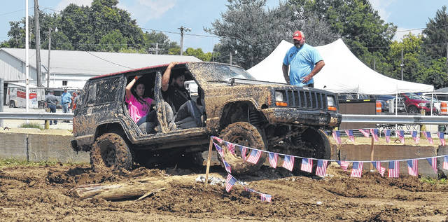 Jeep drivers from near and far gave their vehicles a new coat of mud as they tried out the Jeep Jam's obstacle course at the Clinton County Fairgrounds on Saturday. The night ended with Southern sounds of Moccasin Creek followed by Molly Hatchet.