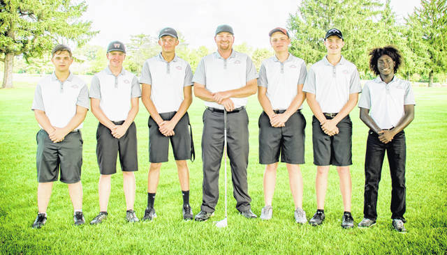 The Wilmington High School boys golf team, from left to right, Ryan Lewis, Jack Murphy, Zane Carey, head coach Phil Gilmore, Brendan Powell, Braydon Conley, Ely Schumacher.