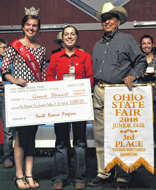 Gracee Stewart of Clinton County, center foreground, is awarded $1,500 for placing 3rd in Ohio State Fair competition for being an outstanding exhibitor of a market barrow.