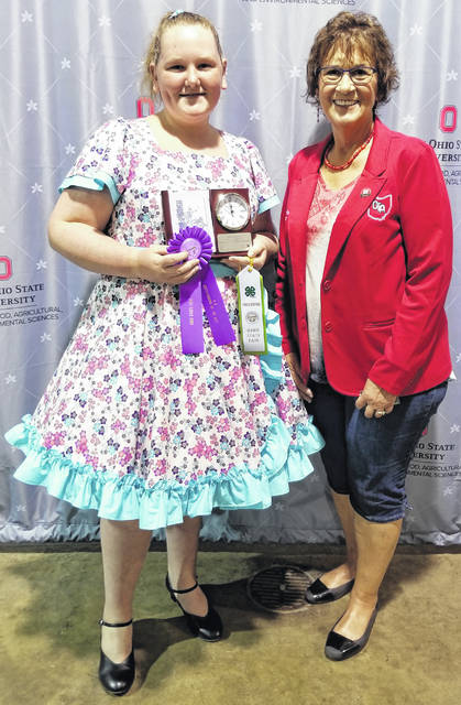 Sew Grate 4-H Club member Jenna Allemang of Wilmington won Outstanding of the Day and 1st place overall in Intermediate Active Sportswear at the Ohio State Fair on Aug. 1. Jenna sewed a Square Dance Dress which she will wear with her group the Clinton County Squares. The 1st-place clock trophy was presented by Connie Fink, President of the Ohio Township Association, sponsor of the trophy.