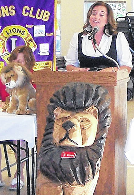 CEO/President of United Way of Clinton County Amanda Harrison, right, addresses the Wilmington Lions Club. In the left background is Lion Susan Henry, club secretary, partly hidden.