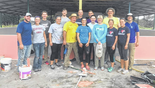 the Faith Lutheran Church missin team at the open air cafeteria. From left are: front, Ryan Roberts, Jessica Gruhot, Delaney Roberts, Larry Roberts, Allison Brooks, Pastor June Fryman, Terri Roberts, and Kinsey Carroll; back, Heather Fryman, Roby Ruppert-James, Brian James, Cedric and Sarah (Fryman) Gegel, Jeff Fryman, and Danny Carroll.