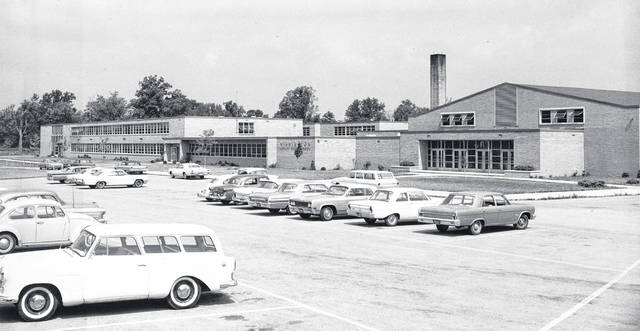 """This photo of Wilmington High School was apparently taken in 1966. Do you recognize any of the cars? Does the photo bring back some memories? Let us know at info@wnewsj.com. Also, with last week's photo we asked the public for help identifying the young ladies in the photo labeled, """"Driving course, July 1938, the first given by the Highway Patrol."""" Susan Henry let us know that the second woman from the left was her mother, Martha Jo Starbuck; and fourth from the right was Rose Lee Garland."""