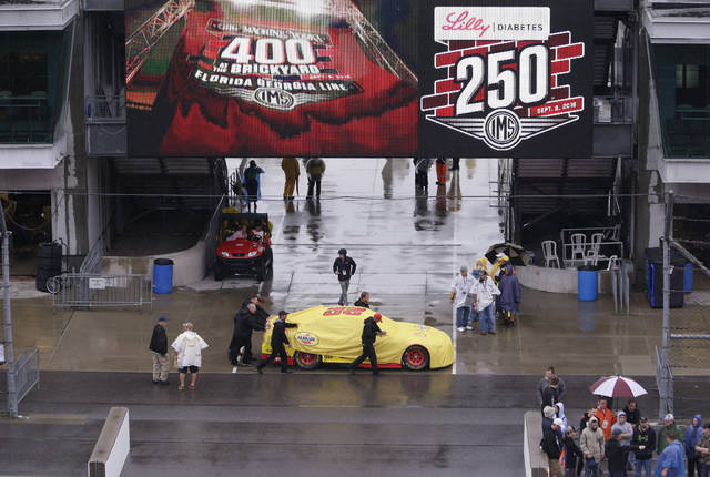 The car driven by NASCAR Cup Series driver Joey Logano (22) is pushed though the garage area as rain cancelled track activity for the Brickyard 400 auto race at Indianapolis Motor Speedway, in Indianapolis Saturday, Sept. 8, 2018. (AP Photo/AJ Mast)