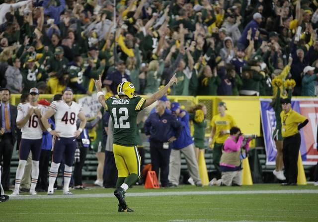 Green Bay Packers' Aaron Rodgers reacts after throwing a 75-yard touchdown pass to Randall Cobb during the second half of an NFL football game against the Chicago Bears Sunday, Sept. 9, 2018, in Green Bay, Wis. (AP Photo/Mike Roemer)