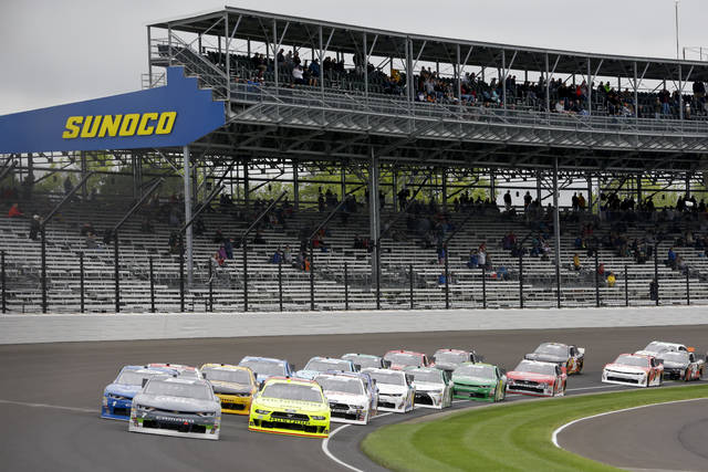 NASCAR Xfinity Series driver Justin Allgaier (7) leads the field through the first turn on the start of the Xfinity auto race at Indianapolis Motor Speedway, in Indianapolis Monday, Sept. 10, 2018. (AP Photo/AJ Mast)