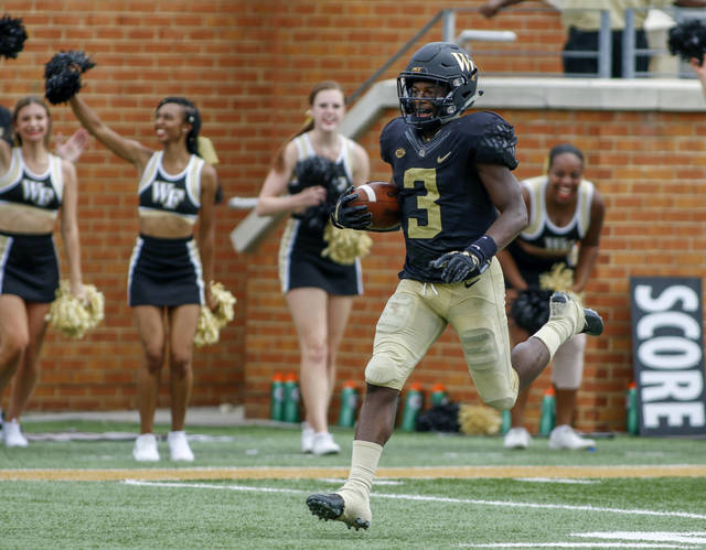 Wake Forest punt returner Greg Dortch runs back a punt for a touchdown against Towson in the first half of a NCAA college football game in Winston-Salem, N.C., Saturday, Sept. 8, 2018. (AP Photo/Nell Redmond)