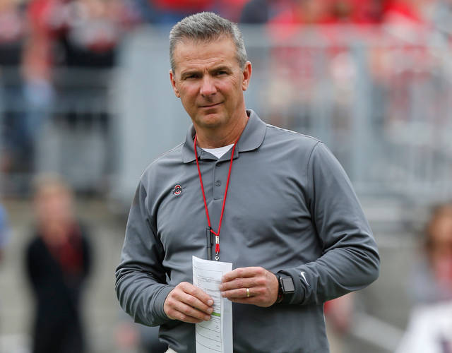 FILE - In this April 14, 2018, file photo, Ohio State coach Urban Meyer watches the NCAA college football team's spring game in Columbus, Ohio. Ohio State has made it through two games fine without Meyer. Now the No. 4 Buckeyes face their toughest test on the last Saturday before their suspended coach can return to the sideline. (AP Photo/Jay LaPrete, File)