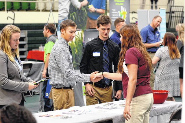Freshmen Wyatt Snyder, left, and Justin Hunt meet with Kyle Roe of Hord Family Farm, a Bucyrus-based livestock producer. Roe is a 2016 WC graduate who returned to her alma mater to recruit students for jobs and internships with her employer.