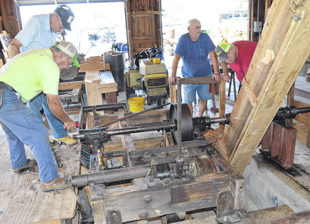 Jim Campbell and Raymond Smith (at left) and other members of the Antique Power Club work on Tuesday to prepare the old sawmill for demonstrations to attendees at this year's 41st Annual Clinton County Corn Festival. The family friendly salute to everything agriculture (and more) begins Friday and continues through Sunday at the fairgrounds. For a complete preview of the festival, see Thursday's News Journal and wnewsj.com.