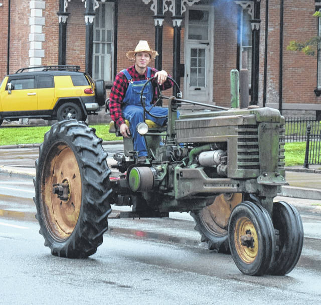 The weather couldn't (completely) dampen the annual Corn Festival parade through downtown Wilmington on Saturday morning, as well as the rest of the festival on Saturday and Sunday at the fairgrounds. Crowds were down especially Saturday as Mother Nature brought a steady diet of drizzzle to showers to downpours.