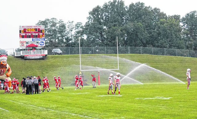 During pre-game warmups at last week's game in Hillsboro, East Clinton players were doused with a little extra water as the in-field sprinklers came on.