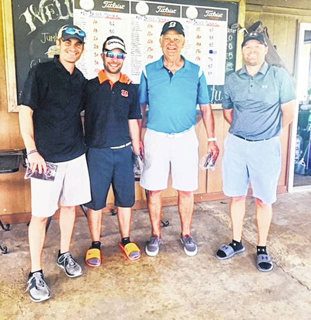 The winning team in the final Ken Briggs Memorial Golf Tournament, from left to right, Ryan Briggs (Ken Briggs' son), Brent Carter, Bob Carter and Tim McGraw. Winning team member Jeremy McGraw was not present for the photograph.