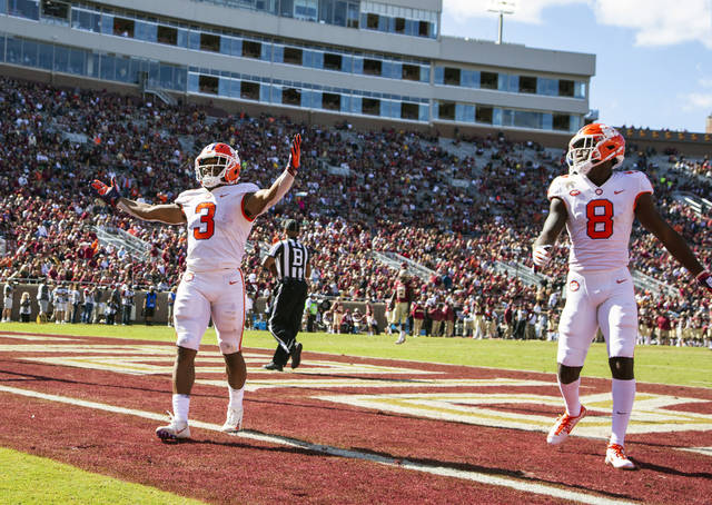 48afd3362 Clemson wide receiver Amari Rogers celebrates his 68-yard reception and run  for a touchdown in the second half of an NCAA college football game against  ...