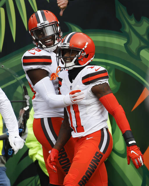 db373e4cc6c8 Cleveland Browns wide receiver Antonio Callaway (11) celebrates his  touchdown with tight end David Njoku